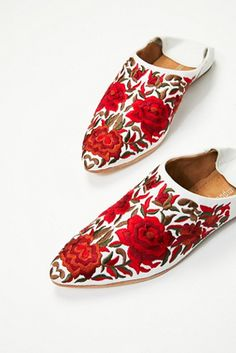 Cava Flat | Slip-on leather flats featuring beautiful floral embroidery detailing.    * Pointed toe.   * Soft back converts this flat into a mule.   * Handmade leather sole.