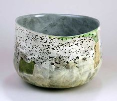 Ceramics by Anna Lambert at Studiopottery.co.uk - 2014. Aire valley floods and rooks, dimple based bowl, height 23 x diameter 28cm. £450. <br><br> Slab built from a white earthenware mixed clay, with stamped, impressed, modelled and stencilled details, inlaid or painted slips and underglaze painting.<br> The pieces are finished in a transparent lead based glaze.