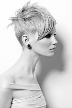Short haircut with disconnected top. Very versatile and fashion-forward!