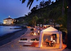 Santa Catalina Island's Descanso Beach Club with a view of the Avalon Casino at night