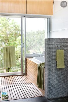 Choose materials that are consistent with the outdoors to make it easy for the eye to travel from inside to out