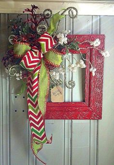 Repurposed old frame painted add embellishments and a bow and you got a unique Christmas wreath