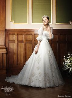 White wedding dress with full skirt & elbow length shrug from Royal Wedding by Takami Bridal.