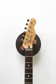 """The Simple """"Hyla"""" Wall Guitar Stand by Hudson Valley Hard Goods (Diy Wood Work Projects) Diy Guitar Stand, Guitar Display, Music Stand, Hudson Valley, Wood Projects, Woodworking Projects, Guitar Wall Hanger, Guitar On Wall, Music Guitar"""