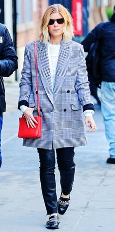 Look of the Day › February 23, 2014 WHAT SHE WORE Mara took a stroll in NYC in a black-and-white double-breasted plaid Michael Kors coat with a white top and black leather moto pants. A bright red cross-body purse, sunglasses, and chain-accented loafers gave her look a playful spin.