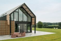 Contemporary barn house situated in Nukerke, Belgium, designed by Sito-architecten.