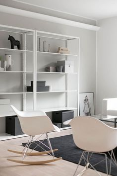 White metallic Ikea 'Fjälkinge' shelves WIth chairs! Scandinavian Interior Design, Gray Interior, Living Room Interior, Living Room Decor, Ikea Inspiration, White Eames Chair, Ikea Shelves, Home Trends, Interiores Design