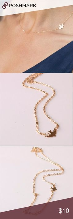 """Dainty Gold Dove Choker Necklace This  is a dainty choker necklace with a dove on it to be worn on the side of the neck. It is made of plated gold. It measures 16"""" long.  It a pretty jewel to add to your collection. Jewelry Necklaces"""