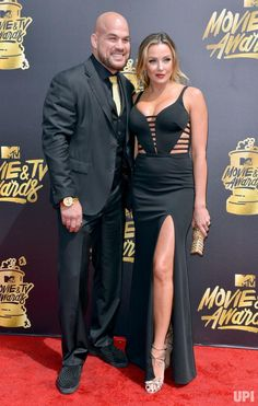 MMA fighter Tito Ortiz (L) and Amber Nichole Miller attend the MTV Movie & TV Awards at the Shrine Auditorium in Los Angeles on May 7,…