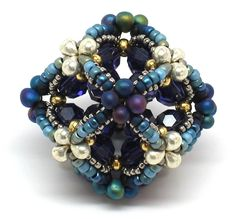 """Blog of Gwen Fisher (http://gwenbeads.blogspot.com). September 28, 2010. """"Ionic Rhombic Dodecahedron and Cuboctahedron"""" beaded bead."""