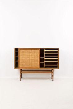 Hans Wegner; Teak, Rosewood and Rattan Cabinet for Andreas Tuck, 1950s.