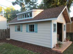 Cute shed!  DIY shutters.