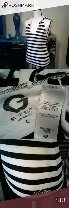 """Guess hooded tank top Women's very gently pre loved black/white G by Guess hooded tank top with built in bra size Small. Measurements Chest 13"""" length 20"""". Thanks for looking Bundle to save!! Guess Tops Tank Tops"""