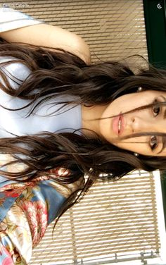 Camila Cabello showed off her pretty waves in a stunning new Snapchat selfie. The Fifth Harmony singer's silky top is so glam too!
