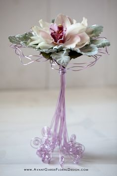 Curled Wire stems add whimsy and style to this simple bouquet of just a few Cymbidian orchids... would make excellent, unique and unusual bridesmaid bouquets for the bride who wants something different or more modern