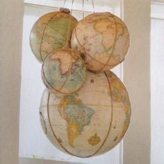 Hang globes from the ceiling to inspire your lil explorer