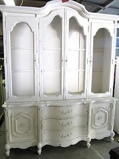 painted white hutch ... again, something like this for storing baby items in would be awesome.