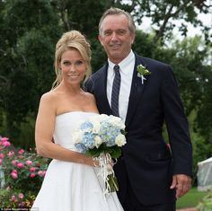 Meet Mr & Mrs Kennedy: Cheryl Hines and Bobby Kennedy said 'I Do' on August 2 on a wedding day rocked by a torrential downpour