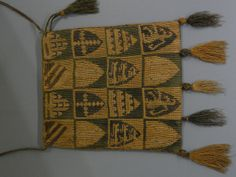 Medieval heraldic bag from the 14th century featuring long-legged cross-stitch embroidery.