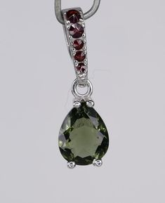 Stone Jewelry Diy Faceted genuine 9 mm large Moldavite oval shape with small Garnet sterling silver pendant.This item is available in multiple quantity,each piece is more less the same.Price is per one pc) piece. Stone Jewelry, Boho Jewelry, Jewelry Gifts, Jewellery, Organic Glass, Christmas Jewelry, Sterling Silver Pendants, Garnet, Bling