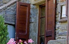 Original 14th century low doorways and small windows cut through thick stone walls lend an authentic feel