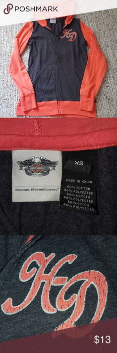 Harley Davidson zip up hoodie Women's size XS Harley Davidson zip up hoodie. Pretty charcoal gray with dark coral contrast color. HD logo on front breast and classic Harley logo on back bottom. As pictured, lettering is distressed. This was given to me and it looks like the distressing is part of the design and not from wear, but I'm not sure. Otherwise good pre-owned condition with tiny spot on hood, as pictured. Not sure if it will come out. Lightweight cotton/poly blend. Perfect for…