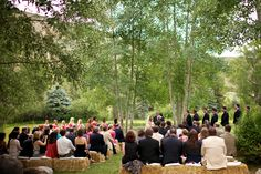 Mountain Meadow wedding with haybale seats