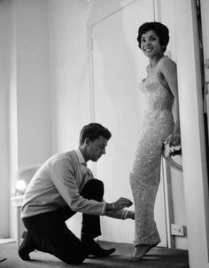 Thats right #Oscars audience, STAND UP for Dame Shirley Bassey! She is 76 today and still as gorgeous as she was in this 1960 photo where she is being fitted for a new sheath dress, covered with 156,000 diamante stones (weighing in at 28 pounds), by designer Douglas Darnell. Photo by Peter Hall/Keystone Features/Getty Images.