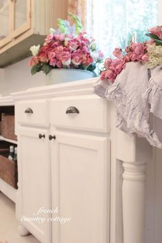 Vintage inspired farmhouse Kitchen and making RTF cupboards custom with stair posts.