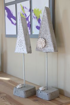 Modern take on Christmas Trees.  In concrete with white grout and little plaster flowers.