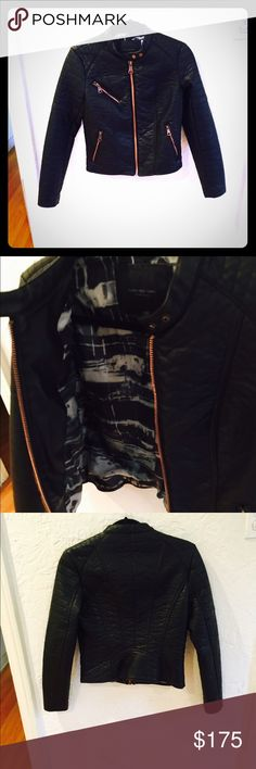Marc New York leather jacket. Size XS. NEW!! Black quilted leather jacket with bronze hardware. Edgy and stylish. Interior: silky multi-color print. Size XS. NEW!!! Marc New York by Andrew Marc Jackets & Coats