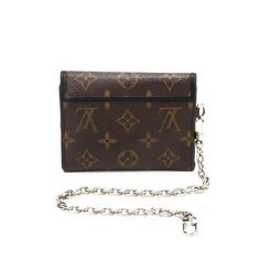 a87561872d00 Brown canvas  LouisVuitton  Portefeuille  Compact. Available at lxrco.com  for  399