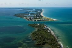 Island Secret #114 Captiva Island's north end used to be connected to today's North Captiva Island by a neck known as The Narrows.  A 1921 hurRedfish Passricane broke that neck to create Redfish Pass, christened as such because, for still unknown reasons, redfish ran through the pass so profusely that the waters looked red.  The phenomenon has never happened again since, much to the chagrin of those in quest of the prized food fish!
