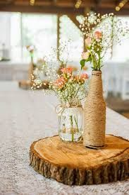 Love those rustic and wooden centerpieces for wedding table! How to Create those Stunning Handmade Wedding Table Decorations - Be at one with the trees Rustic Wedding Centerpieces, Wedding Table Centerpieces, Centerpiece Ideas, Beer Bottle Centerpieces, Homemade Wedding Decorations, Centerpiece Flowers, Flower Arrangements, Wooden Centerpieces, Vase Ideas