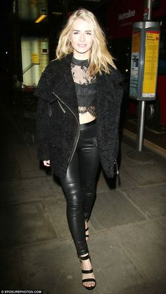 Leggy in leather: Lottie Moss looked incredible in a black lace crop top and a pair of skin-tight trousers as she left the Centrepoint Ultimate Pub Quiz in London on Tuesday