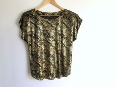 Black + Gold Disco Top / Shiny Gold on Black Slinky Fabric Blouse / Day Glamour Gold + Black Shirt / Cap Sleeve Golden T-Shirt by ShopRachaels on Etsy https://www.etsy.com/listing/509121699/black-gold-disco-top-shiny-gold-on-black