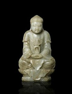 A rare Imperial pale green jade figure of Buddha, 18th century