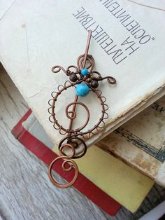Hey, I found this really awesome Etsy listing at https://www.etsy.com/listing/193559734/shawl-pin-turquoise-and-copper-wire