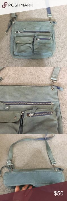 Fossil blue green soft leather cross-body vtg Vintage fossil Crossbody messenger style bag has several pockets and zippered pockets on the outside as well as two pockets and a zipper pocket in the inside fossil soft leather bag authentication number 75082 with adjustable straps very nice non-smoking home fast delivery at an excellent price get it today Fossil Bags Crossbody Bags