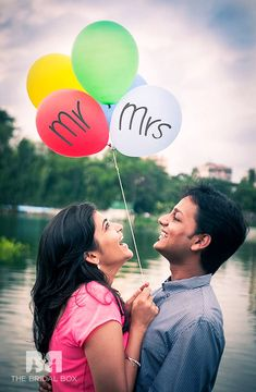 Balloons show happiness, hence using it as a prop for your pre-wedding shoot would be a great idea. Either you can pose with it like you're flying high in the sky or pose with the balloon with Mr & Mrs written on it. Pre Wedding Poses, Pre Wedding Shoot Ideas, Pre Wedding Photoshoot, Prewedding Photoshoot Ideas, Indian Wedding Photography Poses, Couple Photography Poses, Photography Ideas, Indian Wedding Poses, Candid Photography