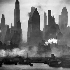 Photo by Andreas Feininger. The New York harbor: looking down 42nd street in midtown Manhattan. This photo was taken 2 miles away from the shore of New Jersey with a 40-inch Dallmeyer lens - 1946.