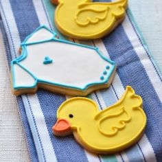 Baby shower duck and onesie sugar cookies with royal icing