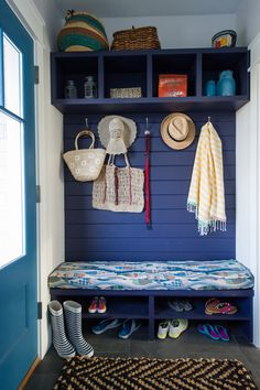 Cubbies in Olympic Paint's Black Flame and a custom-cushioned storage bench are the perfect place to ditch dirty shoes and stash various belongings.