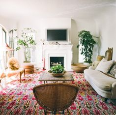 bright pink carpet with neutral furniture and white walls / Lauren Soloff Los Angeles House | Remodelista
