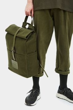 Read about Design & Production Top Roll rucksack has afront magnet pocket,interior pockets for chargers and personal organizing,interior padded cotton po
