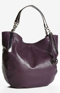 Free shipping and returns on MICHAEL Michael Kors 'Julian - Large' Shoulder Tote at Nordstrom.com. Logo-embossed hardware provides understated branding to a roomy tote cut from glazed leather and topped with jewelry-inspired linked chain handles. A cutout logo medallion dangles at one side for a signature finish.