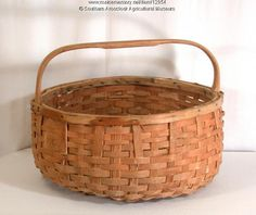 Potato Basket, Littleton, ca. 1940. Maliseet and Micmac Indians made this style of traditional Maine basket for harvesting potatoes by weaving splints made of brown ash. Item # 12954 on Maine Memory Network