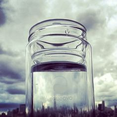 @Chris Glass Is Life 's reusable #Therm-O bottle  by #AQUAOVO in front of the stormy NYC skyline. Happy #WED2012! #glassislife