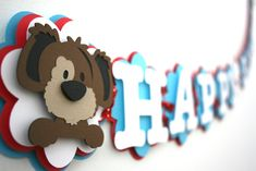 This adorable puppy banner is perfect for your little ones party. The banner is made of heavy card stock and held together with brads. The layers are lifted to give it dimension. The banner reads HAPPY BIRTHDAY.   Please feel free to message me with any questions or requests. Thanks! Cindy  To see the matching high chair banner, click the link below: https://www.etsy.com/listing/222892070/puppy-high-chair-banner-puppy-themed?ref=shop_home_active_14