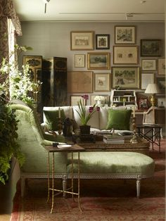 Green velvet chaise longe, neutral walls, salon wall - this room exudes warmth